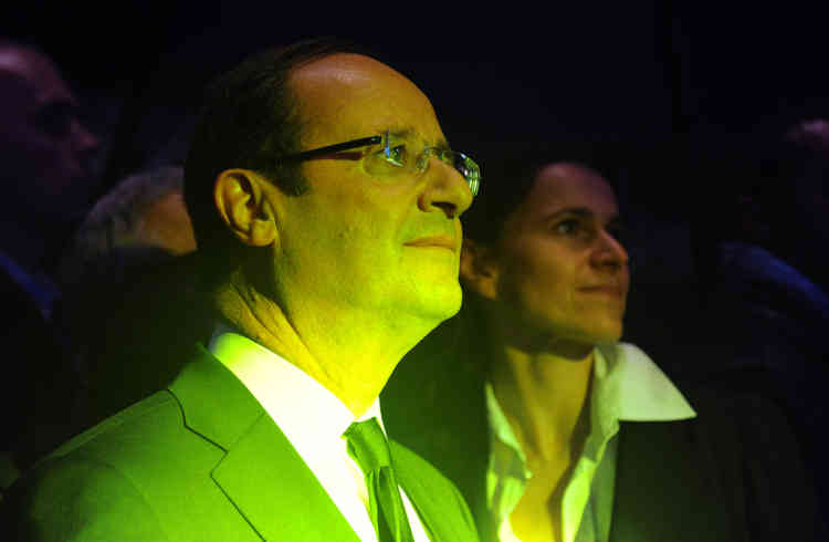 "French Socialist Party (PS) candidate for French 2012 presidential election Francois Hollande (foreground) attends a rehearsal of French band Zebda next to his advisor for Culture Aurelie Filippetti as he visits the 36th edition of the ""Printemps de Bourges"" rock and pop festival as part of his campaign, on April, 27, 2012, in the French central city of Bourges. AFP PHOTO ALAIN JOCARD"