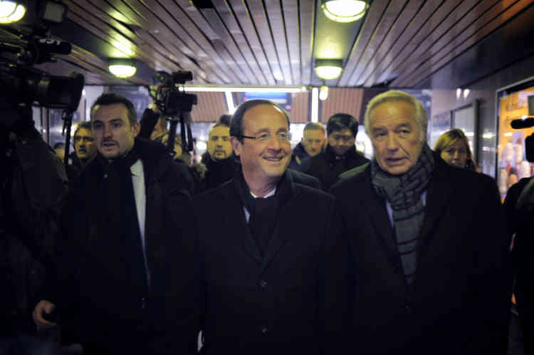 France's Socialist Party (PS) candidate for the 2012 French presidential election Francois Hollande (C) speaks with French socialist senator and Dijon's mayor François Rebsamen (Ras he arrives at Dijon's railway station, on February 6, 2012, at the beginning of a campaign visit. AFP PHOTO / JEFF PACHOUD