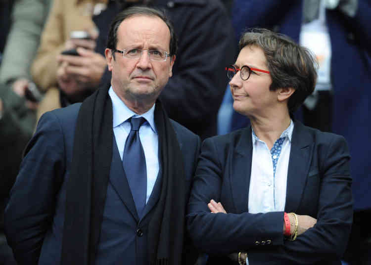 France's opposition Socialist Party (PS) candidate for the 2012 French presidential election François Hollande (L) speaks with Rouen's mayor and Sports' advisor Valérie Fourneyron prior to the rugby union 6 Nations tournament match France versus England, on March 11, 2012 at the Stade de France in Saint-Denis, outside Paris. AFP PHOTO / FRANCK FIFE