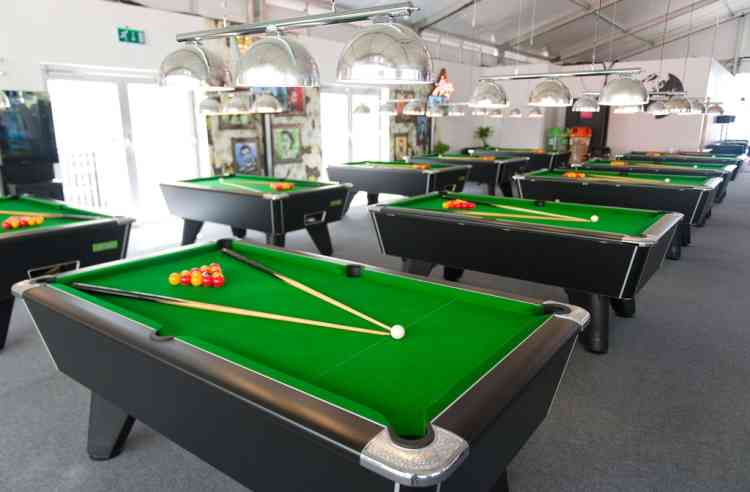 Pool tables are in pictured in one of the social areas inside the London 2012 Olympic Athletes Village in the Olympic Park in east London, on July 12, 2012. The 2012 Olympic games will begin on July 27, 2012. AFP PHOTO/LEON NEAL