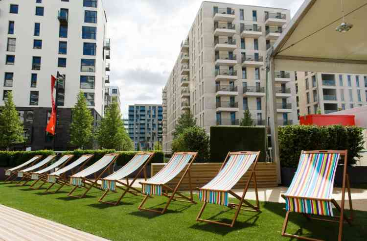 Deckchairs are lined up outside one of the social areas inside the London 2012 Olympic Athletes Village in the Olympic Park in east London, on July 12, 2012. The 2012 Olympic games will begin on July 27, 2012. AFP PHOTO/LEON NEAL