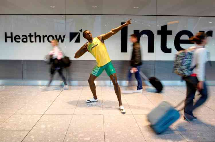 A handout picture obtained in London on July 12, 2012, shows a wax model of Jamaican sprinter Usain Bolt which was unveiled Thursday by Madame Tussauds at Heathrow Airport's Terminal 5. The wax figure is expected to remain at Heathrow Airport for the next two weeks. The London 2012 Olympic Games starts on July 27, 2012. RESTRICTED TO EDITORIAL USE-MANDATORY CREDIT *AFP PHOTO/ROSIE HALLAM/MADAME TUSSAUDS/ HO* - NO MARKETING, NO ADVERTISING CAMPAIGNS - DISTRIBUTED AS A SERVICE TO CLIENTS