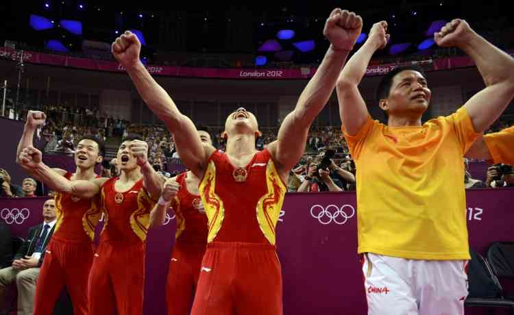 China's team celebrates after the men's gymnastics team final in the North Greenwich Arena during the London 2012 Olympic Games July 30, 2012.  REUTERS/Dylan Martinez (BRITAIN  - Tags: SPORT OLYMPICS SPORT GYMNASTICS TPX IMAGES OF THE DAY)