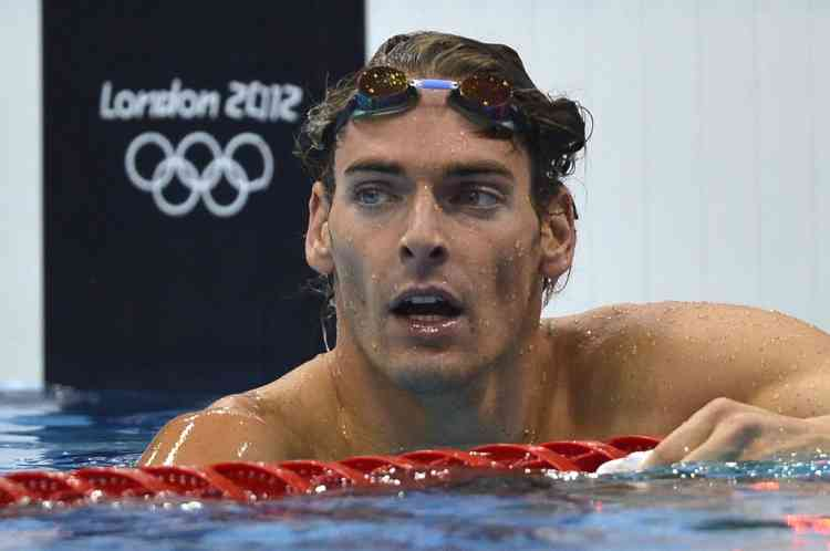 France's Camille Lacourt is pictured after the men's 100m backstroke semi-final swimming event at the London 2012 Olympic Games on July 29, 2012 in London.        AFP PHOTO / FABRICE COFFRINI
