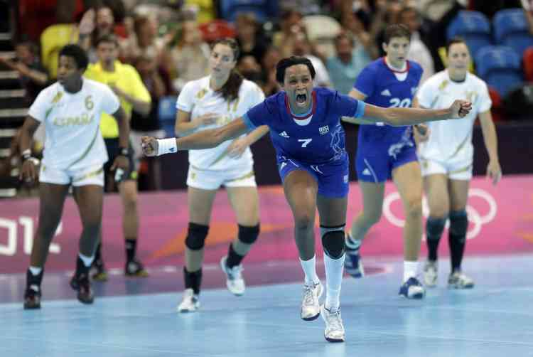 Allison Pineau of France celebrates after scoring during their women's handball preliminary match against Spain at the 2012 Summer Olympics, Monday, July 30, 2012, in London. (AP Photo/Matthias Schrader)