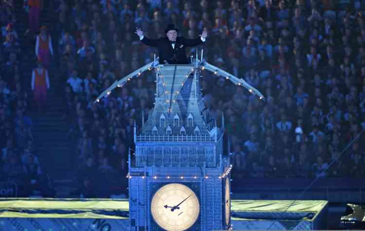 British actor Timothy Spall poses as late former prime minister Winston Churchill at the top of a replica of the tower housing Big Ben during the closing ceremony of the London 2012 Olympic Games in the Olympic Stadium in east London on August 12, 2012. Rio de Janeiro will host the 2016 Olympic Games.  AFP PHOTO / JOHANNES EISELE
