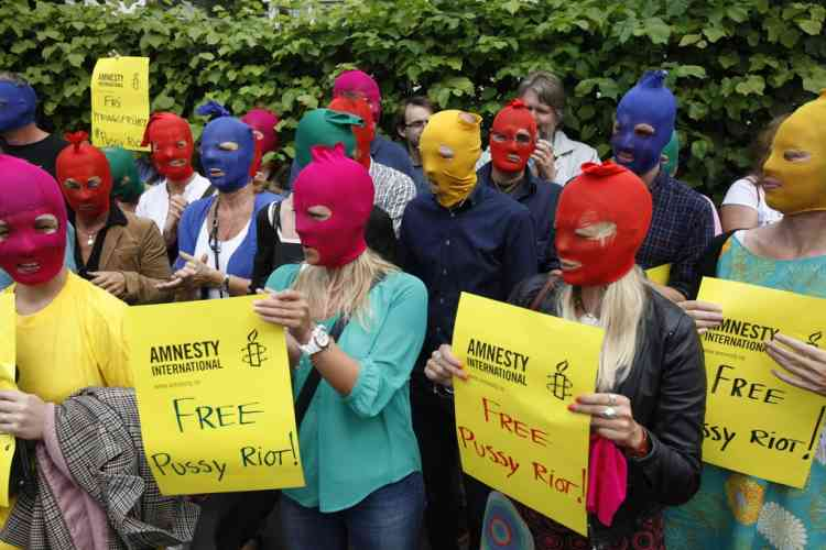 Members of Amnesty Norway demonstrate against the verdict of the trial of three members of Russian punk band Pussy Riot, outside the Russian embassy in Oslo August 17, 2012. A judge sentenced three women who staged an anti-Kremlin protest on the altar of Moscow's main Russian Orthodox church to two years in jail on Friday in a trial seen as test of President Vladimir Putin's tolerance of dissent. REUTERS/Anette Karlsen/NTB Scanpix (NORWAY - Tags: CRIME LAW POLITICS CIVIL UNREST ENTERTAINMENT) THIS IMAGE HAS BEEN SUPPLIED BY A THIRD PARTY. IT IS DISTRIBUTED, EXACTLY AS RECEIVED BY REUTERS, AS A SERVICE TO CLIENTS. NORWAY OUT. NO COMMERCIAL OR EDITORIAL SALES IN NORWAY. NO COMMERCIAL SALES