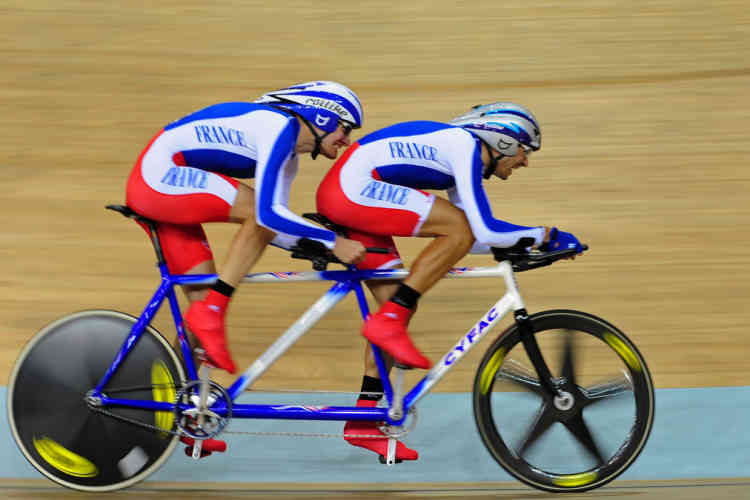 (CORRECTION) Olivier Donval (L) and John Saccomandi (R) of France compete in the men's individual pursuit (B&VI) cycling track competition during the 2008 Beijing Paralympic Games on September 7, 2008 at the Laoshan Velodrome. More than 4,000 athletes from 150 countries are participating in the 20 Paralympics sports, the most in Paralympcs history, and organisers say they are making arrangements for tens of thousands of disabled people to attend the Games.    AFP PHOTO /Frederic J. BROWN