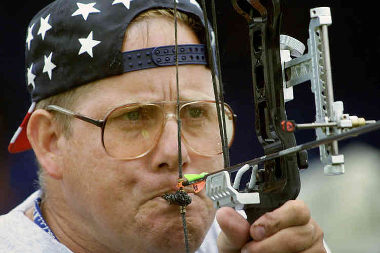Larry Townes from the USA uses his mouth to draw back his bow during the semi-final of the Mens Individual W1 Archery at the eleventh Paralympic Games in Sydney October 24, 2000. Townes finished fourth in the competition with 280 points. More than 4000 disabled athletes from 125 countries are competing in 18 sports at the eleventh Paralympic Games.