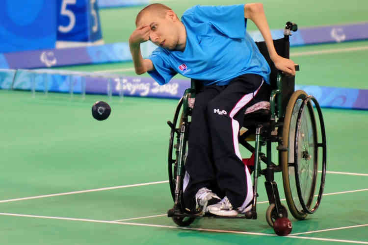 An athlete follows his shot during a training session for Boccia at the Fencing Hall of the National Indoor Stadium in Beijing on September 4, 2008 ahead of the 2008 Beijing Paralympic Games which run from September 6 to 17th. More than 4,000 athletes from 150 countries will participate in the 20 Paralympics sports, the most in Paralympcs history, with many competitions due to be held in the same venues Beijing built to host the recently-ended Summer Olympics during the 12-day event. Similar to Bocce, Boccia is a sport for athletes with a disability, designed to be played by people with cerebral palsy and other locomotive disabilities that affect motor skills, and one of three Paralympic sports with no counterpart in the Olympic program. AFP PHOTO /Frederic J. BROWN