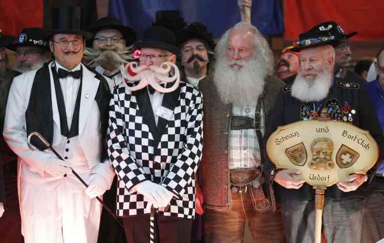 Participants take part in the 2012 European Beard and Moustache Championships in Wittersdorf near Mulhouse, Eastern France, September 22, 2012. More than a hundred participants competed in the first European Beard and Moustache Championships organized in France. REUTERS/Vincent Kessler (FRANCE - Tags: SOCIETY)