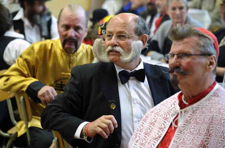 Competitors sit during the first edition of the European Beard and Moustache championships on September 22, 2012 in Wittersdorf, eastern France.  AFP PHOTO / SEBASTIEN BOZON