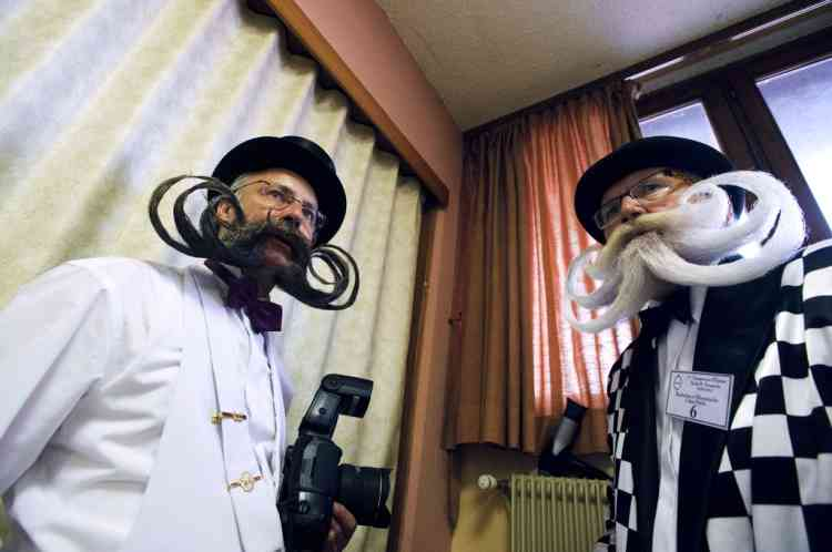 Competitors wait backstage prior to go on stage during the first edition of the European Beard and Moustache championships on September 22, 2012 in Wittersdorf, eastern France.  AFP PHOTO / SEBASTIEN BOZON