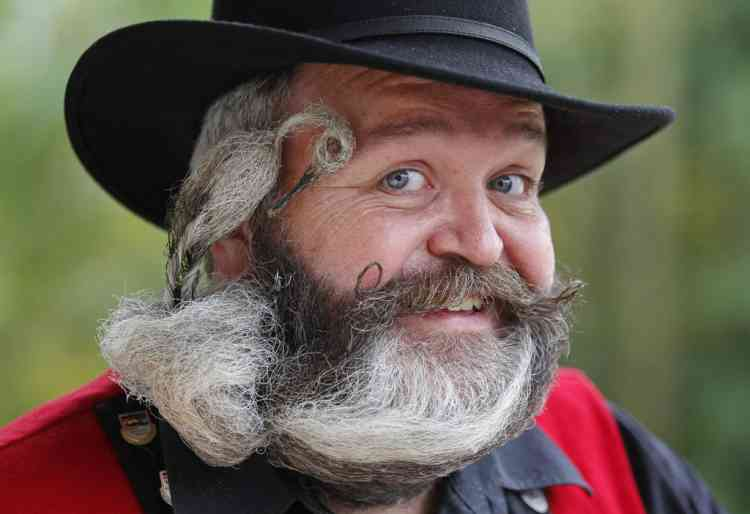 German hairdresser Elmar Weisser, 48, poses with his beard, which is shaped as a stork, during the 2012 European Beard and Moustache Championships in Wittersdorf near Mulhouse, Eastern France, September 22, 2012. Weisser, who won the World Beard and Moustache Championship in 2011, ranked second in the freestyle category of the European championships on Saturday. Picture taken September 22, 2012. REUTERS/Vincent Kessler (FRANCE - Tags: SOCIETY TPX IMAGES OF THE DAY)