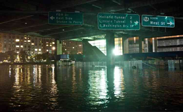 NEW YORK, NY - OCTOBER 29: A flooded street, caused by Hurricane Sandy, is seen on October 29, 2012, in the Financial District of New York, United States. Hurricane Sandy, which threatens 50 million people in the eastern third of the U.S., is expected to bring days of rain, high winds and possibly heavy snow. New York Governor Andrew Cuomo announced the closure of all New York City will bus, subway and commuter rail service as of Sunday evening.   Andrew Burton/Getty Images/AFP== FOR NEWSPAPERS, INTERNET, TELCOS & TELEVISION USE ONLY ==