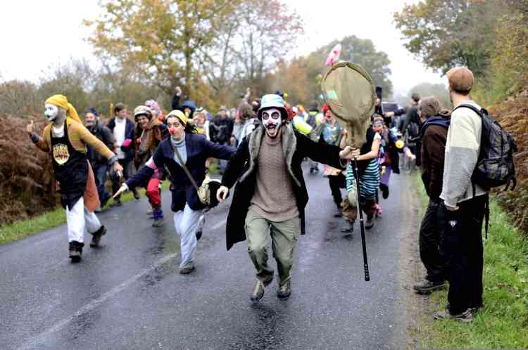 Disguised protesters take part in a demonstration among opponents to a project to build an international airport, on November 17, 2012 in Notre-Dame-des-Landes, western France. The project was signed in 2010 and the international airport is supposed to open in 2017 near the western city of Nantes. AFP PHOTO JEAN-SEBASTIEN EVRARD