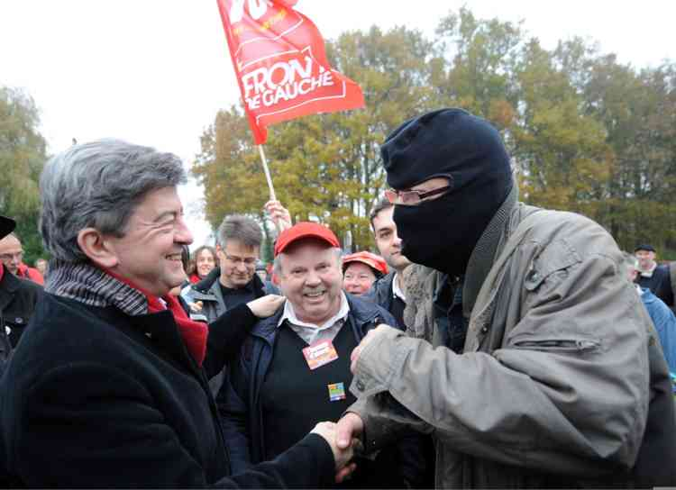 Former French Front de Gauche (FG) leftist candidate for the 2012 French presidential election, Jean-Luc Melenchon (L), takes part in a demonstration against a project to build an international airport on November 17, 2012 in Notre-Dame-des-Landes, western France. The project was signed in 2010 and the international airport is supposed to open in 2017 near the city of Nantes.   AFP PHOTO/JEAN-FRANCOIS MONIER