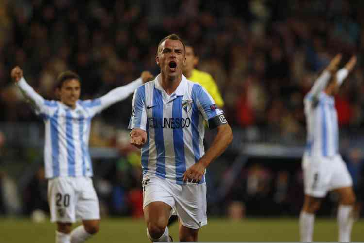 Malaga's Sergio Duda celebrates after scoring a goal against Anderlecht during their Champions League Group C soccer match at La Rosaleda stadium in Malaga, southern Spain December 4, 2012. REUTERS/Jon Nazca (SPAIN - Tags: SPORT SOCCER)