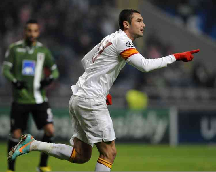 Galatasaray's Burak Yilmaz celebrates after scoring against Sporting Braga during their Champions League Group H soccer match, at the Municipal stadium, in Braga, Portugal, Wednesday, Dec. 5, 2012. (AP Photo/Paulo Duarte)