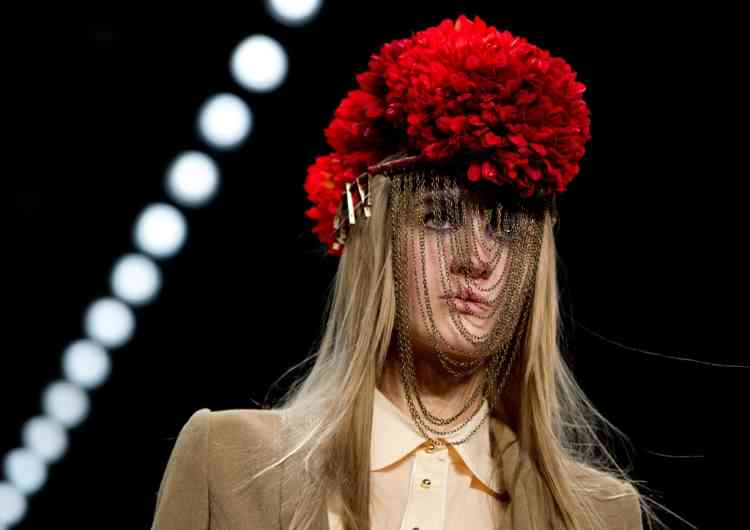 A model presents a creation by designer Rebekka Ruetz during the presentation  of the autumn/ winter collection as part of the Mercedes Benz fashion week in Berlin, Germany, Tuesday Jan. 15, 2013.   (AP Photo/dapd/ Steffi Loos )