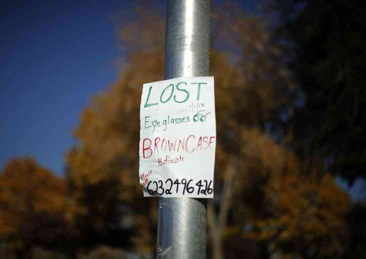 A sign asking for help looking for a lost pair of bifocals is seen in Sun City, Arizona, January 5, 2013. Sun City was built in 1959 by entrepreneur Del Webb as America's first active retirement community for the over-55's. Del Webb predicted that retirees would flock to a community where they were given more than just a house with a rocking chair in which to sit and wait to die. Today's residents keep their minds and bodies active by socializing at over 120 clubs with activities such as square dancing, ceramics, roller skating, computers, cheerleading, racquetball and yoga. There are 38,500 residents in the community with an average age 72.4 years. Picture taken January 5, 2013.  REUTERS/Lucy Nicholson (UNITED STATES - Tags: SOCIETY)