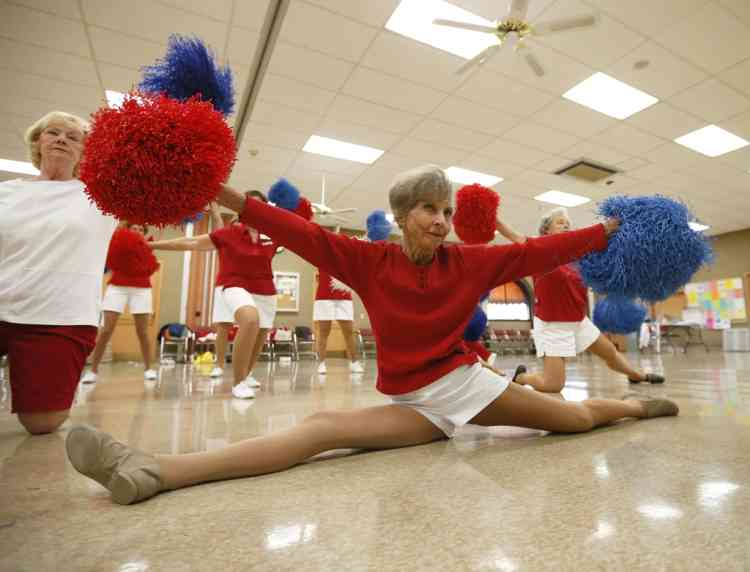 The Sun City Poms cheerleader dancers rehearse in Sun City, Arizona, January 7, 2013. Sun City was built in 1959 by entrepreneur Del Webb as America's first active retirement community for the over-55's. Del Webb predicted that retirees would flock to a community where they were given more than just a house with a rocking chair in which to sit and wait to die. Today's residents keep their minds and bodies active by socializing at over 120 clubs with activities such as square dancing, ceramics, roller skating, computers, cheerleading, racquetball and yoga. There are 38,500 residents in the community with an average age 72.4 years.    Picture taken January 7, 2013.   REUTERS/Lucy Nicholson (UNITED STATES - Tags: SOCIETY)