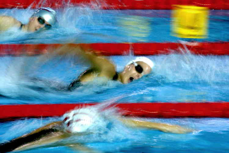 France's Laure Manaudou (C), Russia'a Anastasia Ivanenko and Poland's Paulina Barzycka (top) compete in the women's 400m freestyle heats at the European Swimming Championships Short Course in Trieste, northern Italy December 10, 2005. - RTXO1IP