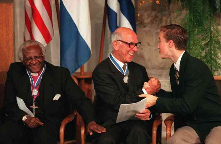 Winner of the Freedom from Want Award, German-born French Ambassador, Stephane Hessel (C) is congratulated by 15-year old winner of the Freedom from Fear Award, founder of the organization ' Free the Children', Canadian Craig Kielburger (R) and winner of the Freedom of Worship Award Archbishop Desmond Tutu during the Awards ceremony of The Franklin D. Roosevelt Four Freedoms Awards in the Dutch town of Middelburg 02 May. The Four Freedoms Medals are presented each year to men and women whose achievements have demonstrated a commitment to those principles which President Roosevelt proclaimed in his historic speech to Congress on 06 January 1941, as essential to democracy : freedom of speech and expression, freedom of worship, freedom from want, freedom from fear.