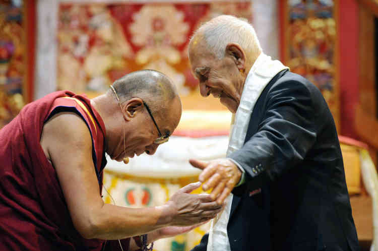 """The Dalai Lama (L) the Tibet's exiled spiritual leader, gives a Buddhist Kata scarf to former French diplomat and author of best-seller """"Time for Outrage !"""" Stephane Hessel (R) on August 15, 2011 at the Paladia hotel in the French southwestern city of Toulouse. The Dalai Lama two-day Buddhist conference on the """"Steps of Meditation"""" and the """"Art of Happiness"""" was attended by more than 7,000 French and foreign followers. AFP PHOTO REMY GABALDA"""
