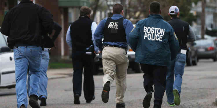 WATERTOWN, MA - APRIL 19: Police officers run towards a home they believed 19-year-old bombing suspect Dzhokhar A. Tsarnaev may be hiding on April 19, 2013 in Watertown, Massachusetts. After a car chase and shoot out with police, one suspect in the Boston Marathon bombing, Tamerlan Tsarnaev, 26, was shot and killed by police early morning April 19, and a manhunt is underway for his brother and second suspect, 19-year-old suspect Dzhokhar A. Tsarnaev. The two men, reportedly Chechen origin, are suspects in the bombings at the Boston Marathon on April 15, that killed three people and wounded at least 170.   Mario Tama/Getty Images/AFP== FOR NEWSPAPERS, INTERNET, TELCOS & TELEVISION USE ONLY ==