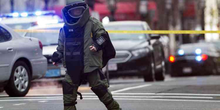 A law enforcement bomb technician walks away after preparing the controlled detonation of a suspicious object during a search for a suspect in the Boston Marathon bombing, in Watertown, Massachusetts April 19, 2013. Police killed one suspect in the Boston Marathon bombing during a shootout and were engaged in a house-to-house search for a second man on Friday in the Boston suburb of Watertown after a bloody night of shooting and explosions in the city's streets.      REUTERS/Lucas Jackson (UNITED STATES - Tags: SPORT ATHLETICS CIVIL UNREST CRIME LAW TPX IMAGES OF THE DAY)