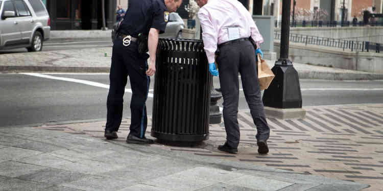 BOSTON, MA - APRIL 19: A Boston Police officer and detective search South Station for suspicious material after two bullets were found outside of the T stop on April 19, 2013 in Boston, Massachusetts. South Station was shut down and heavily guarded with police in response to the early morning shootings in Cambridge and Watertown, Massachusetts. After a car chase and shoot out with police, one suspect in the Boston Marathon bombing, Tamerlan Tsarnaev, 26, was shot and killed by police early morning April 19, and a manhunt is underway for his brother and second suspect, 19-year-old suspect Dzhokhar A. Tsarnaev. The two men, reportedly Chechen origin, are suspects in the bombings at the Boston Marathon on April 15, that killed three people and wounded at least 170.   Kayana Szymczak/Getty Images/AFP== FOR NEWSPAPERS, INTERNET, TELCOS & TELEVISION USE ONLY ==