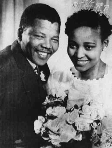 South African anti-apartheid leader and African National Congress (ANC) member Nelson Mandela shown in a file photo dated 1957 posing with his wife Winnie during their wedding.