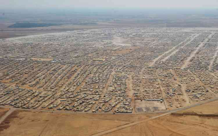 An aerial view shows the Zaatari refugee camp on July 18, 2013 near the Jordanian city of Mafraq, some 8 kilometers from the Jordanian-Syrian border. The northern Jordanian Zaatari refugee camp, now home to 160,000 Syrians, equal in size to what would be Jordan's fifth-largest city. AFP PHOTO/MANDEL NGAN/POOL