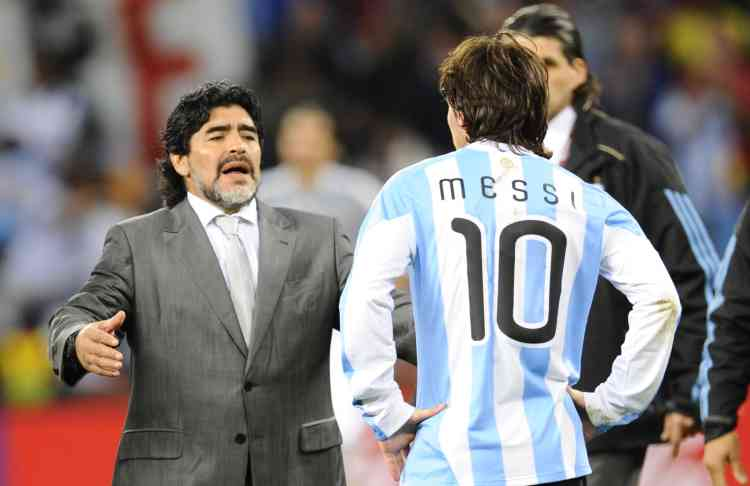 Argentina's coach Diego Maradona (L) looks dejected in front of Argentina's striker Lionel Messi after they lost the 2010 World Cup quarter-final football match Argentina vs. Germany on July 3, 2010 at Green Point stadium in Cape Town. Germany qualified for the semi-finals.  NO PUSH TO MOBILE / MOBILE USE SOLELY WITHIN EDITORIAL ARTICLE -    AFP PHOTO / DANIEL GARCIA