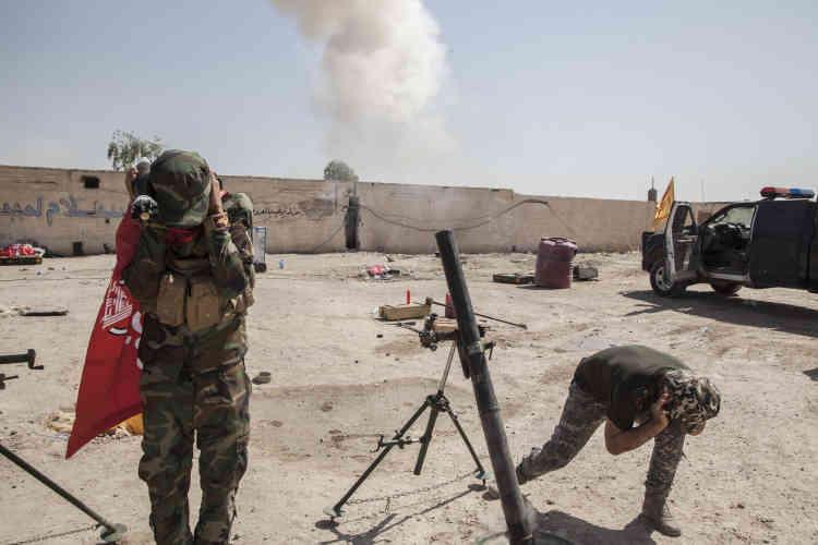 Miliciens chiites et sunnites sont unis pour reprendre le contrôle de la ville.