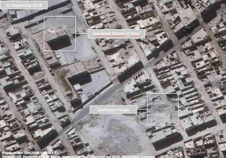 Cette image montre des maisons détruites et une école endommagée dans le quartier Tahal Jabal Badro d'Alep, en Syrie, le 25 septembre 2016.