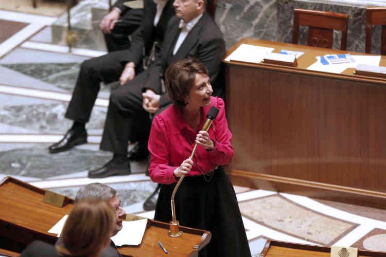 Le 18 décembre 2013. La ministre des affaires sociales et de la santé, Marisol Touraine, s'adresse aux députés après l'adoption de l'avant-projet de loi sur le système de retraite, à l'Assemblée nationale de Paris.