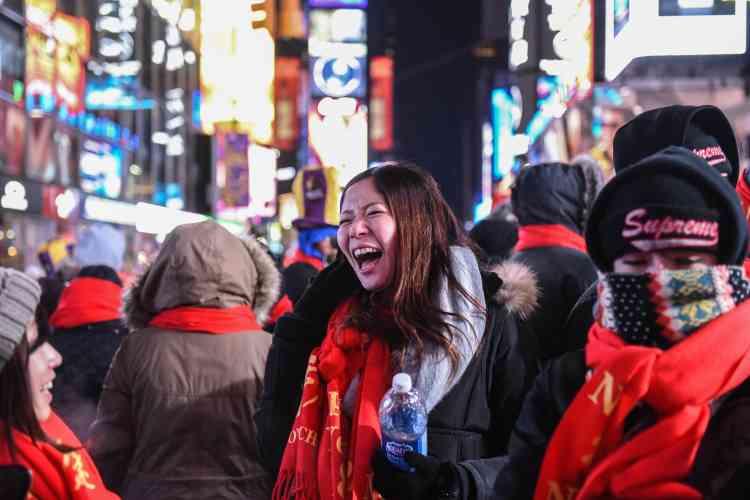 La foule à Times Square, à New York, où des milliers de personnes se rassemblent chaque année.