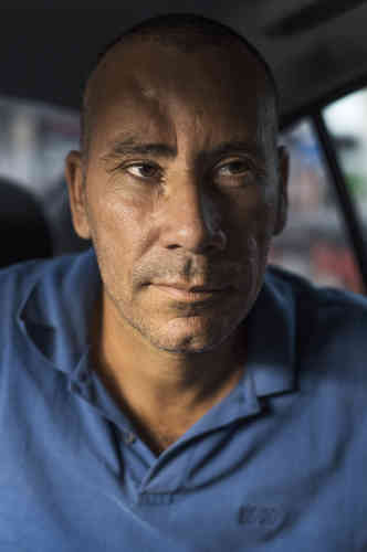 Luiz Carlos, ex-garagiste de Seropedica, reconverti en chauffeur Uber car il était taxé par les miliciens.