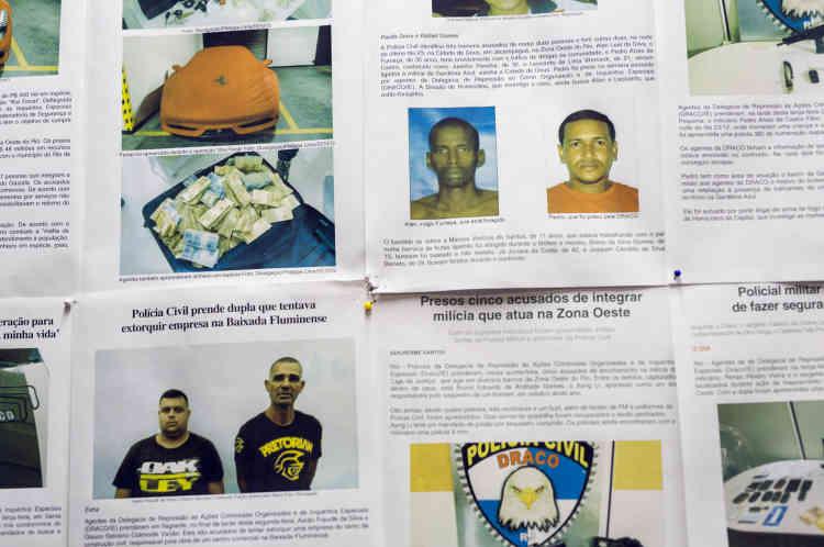 Dans les locaux de la DRACO, la délégation à la répression des actions criminelles et des enquêtes spéciales, une unité triée sur le volet chargée d'enquêtersur les milices et de les appréhender. Au mur, les photos des miliciens récemment arretés.