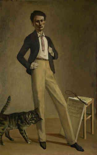 «Dans la vie et l'œuvre de Balthus, les chats ont toujours joué un rôle important. Ils apparaissent souvent dans ses tableaux – la plupart du temps comme alter ego de l'artiste. Dans cette peinture de 1935, en voici un qui se frotte contre la jambe de son maître, de son roi. Et de son dresseur? Un fouet sur le tabouret fait songer à l'instrument pour dompter les fauves. Manifestement, Balthus a d'ores et déjà domestiqué le chat de son tableau.»