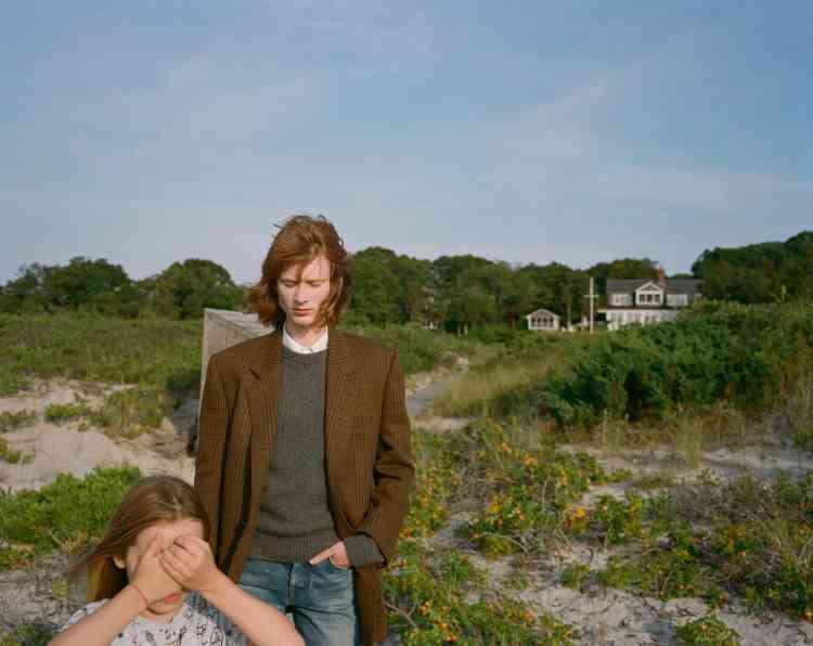 Veste et pull en laine, chemise en coton, jeans, Celine par Hedi Slimane.