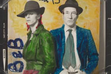 David Bowie et William Burroughs. Photographie de Terry O'Neill, coloriée à la main par David Bowie (1974).