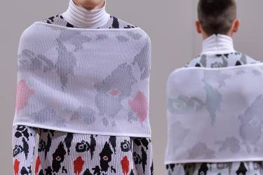A model presents a creation by J.W. Anderson during the Autumn/Winter 2014 London Collections: Men's fashion event in London on January 7, 2014. AFP PHOTO/BEN STANSALL