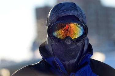 Chris Griesmeyer  dons ski goggles and a mask to protect him from the harsh wind chill as he walked in the sub-freezing temperatures on Monday, Jan. 6, 2014, in Arlington Heights, Ill. Temperatures were expected to plummet further Monday, bringing dangerous cold to parts of the U.S. (AP photo / Daily Herald,  Mark Welsh )   MANDATORY CREDIT; MAGS OUT