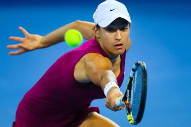 Tennis player Caroline Garcia of France hits a backhand during her first round match against Maria Sharapova of Russia at the Brisbane International tennis tournament at the Patrick Rafter Arena in Brisbane on December 30, 2013. AFP PHOTO / Patrick Hamilton     IMAGE RESTRICTED TO EDITORIAL USE - STRICTLY NO COMMERCIAL USE