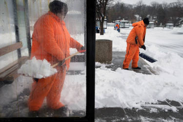 WASHINGTON, DC - FEBRUARY 13: Washington Metropolitan Area Transit Authority employees shovel snow out of bus stops at the Takoma Metrorail Station February 13, 2014 in Washington, DC. Up to 12 inches of snow fell over the Washington area causing WMATA to cancel bus service but rail service continued to operate.   Chip Somodevilla/Getty Images/AFP== FOR NEWSPAPERS, INTERNET, TELCOS & TELEVISION USE ONLY ==