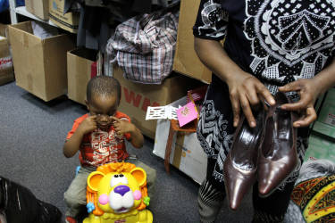 June 2013. Russia. Moscow. Migrants from Africa take clothes in the office of `Civic assistance` organization (photo by Yuri Ivaschenko)