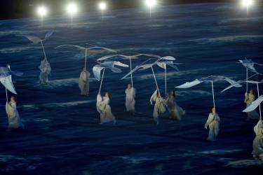 Performers take part in the Closing Ceremony of the Sochi Winter Olympics at the Fisht Olympic Stadium on February 23, 2014. AFP PHOTO / ANDREJ ISAKOVIC